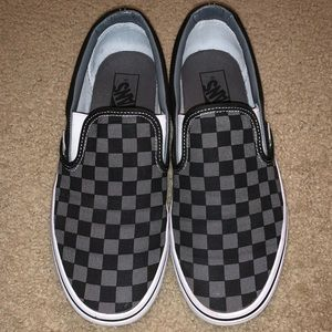 Black and gray checkerboard vans